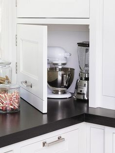Conceal Cumbersome Contraptions--Tired of bulky kitchen appliances crowding your countertops? Stow away toasters, blenders, mixers, and more behind an inconspicuous cabinet panel. The appliance garage also hides electrical outlets for a more attractive appearance.