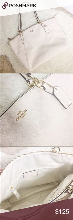 """NWT Coach Small Kelsey Satchel NWT Coach Small Kelsey Satchel. Pebbled leather with polished golden tone hardware. Lined interior with zippered pocket and two open slip pockets. Fully zippered top closure with Coach's removable leather hang tag Dual handles with a drop of 5"""", or use removable shoulder & cross-body strap with 21"""" drop. Measures approximately 10"""" (L) at bottom tapering to 13"""" (L) at top x 9"""" (H) x 2.5"""" (W). 🚫No trades Coach Bags Satchels"""