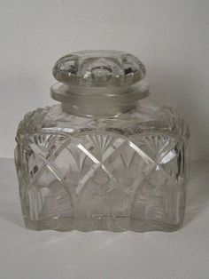 "Cut Glass Tea Caddy, Canister // A nineteenth century heavy quality,lead crystal, large tea caddy or tea canister measuring 6"" long x 3"" deep x 6"" high. With well cut diamonds, slices, fans and star cut base. // Price £165.00 // - Maria Elena Garcia - ► www.pinterest.com/megardel/ ◀︎"