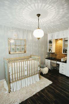 FixerUpper2.11_80 The last room Chip and Jo transformed was the sweetest space in the house: the nursery. Joanna was able to incorporate several of Jill's family heirlooms in this room, adding thoughtful touches of whimsy. She selected bedding from Bella Notte, installed new flooring and painted the walls Grey Screen. This charming little room became the perfect home for the client's baby to be.