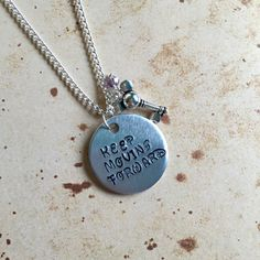 Keep Moving Forward - Hand Stamped Charm Necklace by KawaiiCandyCoutureUK on Etsy https://www.etsy.com/listing/482134014/keep-moving-forward-hand-stamped-charm