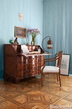 The apartment also came with some lovely antiques, like this Italian marquetry desk in a corner of the living room.   - HouseBeautiful.com