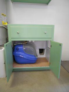 Cat litter box cabinet for garage. Cat enters thru cat door from house. Clean out thru doors on garage side.