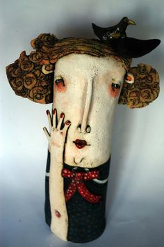 Interesting ceramic piece that reminds me of work created in painted cloth.