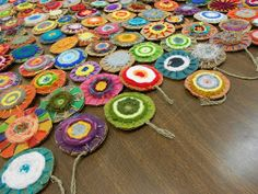 Using cardboard looms all 6th-8th grade art students created two small circle weaving for a permanent collaborative installation in ...