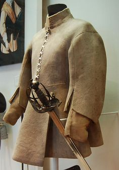 English leather buff coat, 17th century, belonging Sir John Gell (1593-1671), composed of a body, flared skirt and full-length double sleeves. Dimensions: overall height 85.0 cm (33.5 in), width 48.0 cm (18.9 in), neck to waist 37.0 cm (14.6 in), skirt length 38.0 cm (14.9 in), weight: 2.71 kg (6 lb 0 oz), The Royal Armories in Leeds.