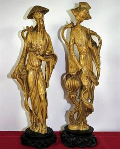 """Vintage Resin Asian Couple Statues. 20"""" tall. Set includes both the man and woman. Perched on wooden bases.Flawless. $125"""