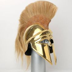 Brass Italo Corinthian Helmet With Beautiful Golden Cream Plume  Fully wearable helmet made of 18 gauge solid brass All Armor products are made from the finest materials with an attention to providing intricate details in each piece Armor is Fully Wearable and Comfortably made strong construction and highly durable  Italo Corinthian Helmet, brass with liner and plume Typical Corinthian helmet shape with horse hair plume. Made of brass. For head cirumference up to 60 cm. - Long distance (back…