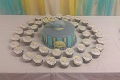 Chocolate cupcakes with buttercream frosting and marshmallow fondant elephant toppers. So adorable!