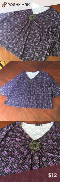 Plus size Brooch Blouse Beautiful purple and black blouse with jeweled black brooch on front. 96% polyester 4% spandex. In beautiful condition and very comfortable and flowy. Apt. 9 Tops Blouses