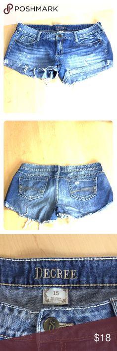 "Decree Distressed Cut Off Jean Shorts Decree cut off jean shorts.  Front pockets with brass with brass rivet accents, distressed fabric and front rolled hems.  Length 10"", Rise 9"", Waist 38"".   EUC.  100% Cotton. Decree Shorts Jean Shorts"