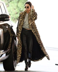 Lean limbs! The Keeping Up With the Kardashians reality star teamed the animal print coat with skintight black leather trousers that showcased her slender stems