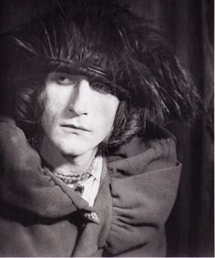 """Man Ray  Rrose Sélavy (1921)  Rrose Sélavy was one of the pseudonyms of artist Marcel Duchamp. The name, a pun, sounds like the French phrase """"Eros, c'est la vie"""", which translates to English as """"eros, that's life"""". It has also been read as """"arroser la vie"""" (""""to make a toast to life""""). Sélavy emerged in 1921 in a series of photographs by Man Ray of Duchamp dressed as a woman. Through the 1920s, Man Ray and Duchamp collaborated on more photos."""