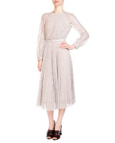 "Erdem ""Rhona"" pleated lace dress. Round neckline. Long semisheer sleeves. Self-belt cinches waist. Full skirt. Ruffled hem. Hidden back zip. Acetate/viscose/spandex. Silk lining. Made in the UK."