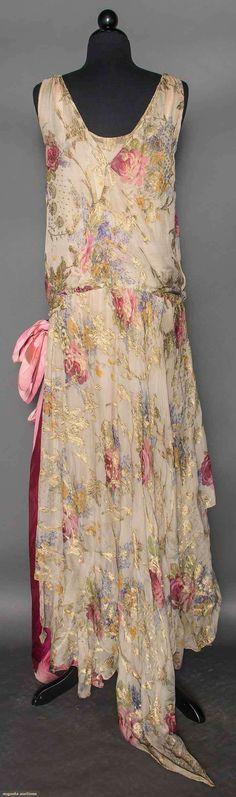 CHIFFON PRINT GOWN , EARLY 1930s. Lilac & rose print & metallic gold lame, sleeveless, drop waist, double layer skirt w/ irregular hems, pink taffeta side sash / Back View.