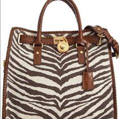 MICHAEL KORS PURSE Michael Kors zebra print purse. Will add picks if interested. Very good condition! Can do 130 on Ⓜ️erc! Michael Kors Bags