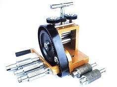 Jewellers mini rolling mill with 7 rolls. Used to apply pressure to metal to flatten and lengthen it therefore it is great for a jeweller. For dimensions as well as more details about the rolls simply click on the image to be taken to our website. (J1140)