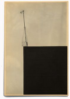 This composition masterfully balances out the big black square on the bottom left with the flower vase sitting on top of it towards the top left, all on top of a clean, white background. The designer then chooses to inject the slightest bit of tension into the controlled balance of the composition by misaligning the vase, with the plant skewing leftward, slightly over the edge of the black square.