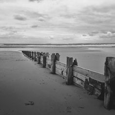 """Wooden groynes Alnmouth beach. I love the word groynes. It has the saucy connotation of the English seaside postcard mixed the language of our European ancestors. It also reminds me of a school geography trip to Durdle Door in Dorset. What was meant to be an exploration of long shore drift and coastal erosion became my first sighting of a pop star. On top of the cliff was an actual Cliff busy filming the video for what would become """"Saviours Day"""". Lacking the earworm audacity of """"Mistletoe…"""