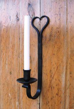 Wrought Iron candle holder. 40.00, via Etsy.