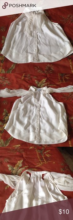 Cream Bebe blouse Razorback style cream colored blouse with smocking at collar and built in tie/scarf. Can wear in or out of clothes, under a jacket. Great addition to a wardrobe bebe Tops Blouses