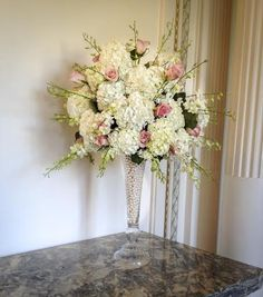 Wedding Centerpiece with white hydrangia, pink roses, pearls, white dendrobium orchids at Tupper Manor