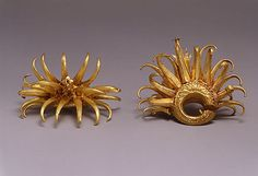 Circular Ear Ornaments with Curving Appendages - 8-10th century Indonesia Gold