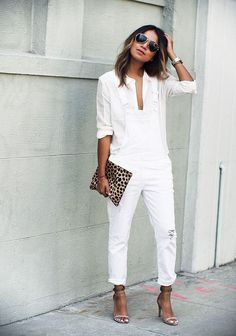 Simple modern look in all white overalls with minimal heels. Notice the all- white buckles on the overalls