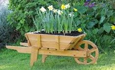 Wooden Wheelbarrow Planter With Free Plansinstructions Tea Tree Garden Wheelbarrow Planter Plans Wooden Planters, Wooden Garden, Diy Planters, Wooden Diy, Planter Ideas, Flower Planters, Woodworking Projects That Sell, Beginner Woodworking Projects, Woodworking Furniture