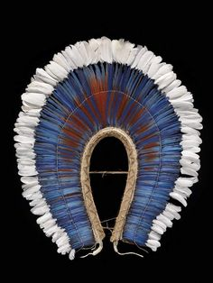 A Mebengokre krokrokti, or feather headdress, from Brazil, is part of the Infinity of Nations exhibit at the National Museum of the American Indian in New York.