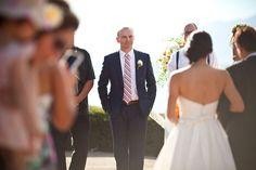 groom watching bride walk down aisle.