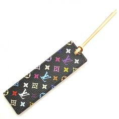 Louis Vuitton bookmark. It's part of the black Murakami multicolor line. This was ONLY given out as a VIP gift to LV's