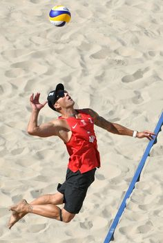 Austria's Alexander Horst serves the ball during the men's beach volleyball qualifying match between Italy and Austria at the Beach Volley Arena in Rio de Janeiro on August for the Rio 2016 Olympic Games. Beach Volleyball, Volleyball Setter, Volleyball Shirts, Volleyball Pictures, Volleyball Clothes, Softball Pics, Olympic Games Sports, Olympic Gymnastics, Rio Olympics 2016