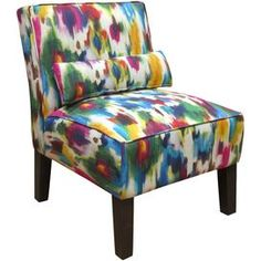 Accent chair with tie-dye-inspired upholstery and matching piped trim. Handmade in the USA.   Product: ChairConstruction Material: Solid pine, polyurethane foam and polyesterColor: Aurora multiFeatures: Handmade Bold tie dye-inspired motifPillow includedDimensions: 33 H x 25 W x 32 D