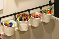 hanging rod-hooks-buckets are from IKEA - for art supplies
