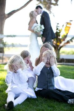 Love this wedding day photo of the kids and the bride an groom. Would be cute…
