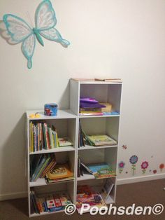 Book shelf and the glitter butterfly flying away