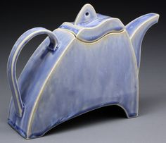 Functional hand-made one of a kind teapot with blue glaze. $60.00, via Etsy.
