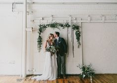 winter garland backdrop Winter Ocean wedding inspiration. flowers by Carolyn Snell. Photo by Emily Delamater http://emilydelamater.com/