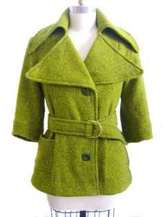 Vintage olive green herringbone wool jacket with belt and oversized collar.