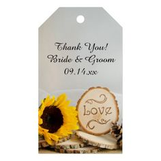 Thank your wedding guests for being a part of your nuptials when you attach the charming #Rustic #Sunflower #Woodland #Wedding #Favor Tag to their wedding favor.  These custom woods or forest wedding thank you favor tags feature a yellow sunflower blossom, wood slices with the word LOVE burned on it, pine cone and white bridal veil with a burlap and white satin background. Perfect for a casual yet classy natural outdoor woodland wedding theme. #weddingfavors #favortags