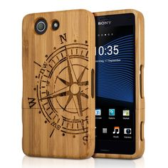 kwmobile Natural wood case with Design compass for the Sony Xperia Z3 Compact in bamboo light brown. WOOD WOOD: Give your Xperia Z3 Compact natural and safe protection against shocks and wear and tear with the protective case made of wood. The Design compass stylishly mixes nature and art. NATURAL BEAUTY: The natural wood looks good. It also brings together material properties that help your smartphone to avoid wear and tear and transform your mobile phone into a cool stylish accessory....