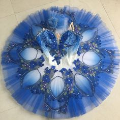 New Ombre Collection Tutu! This blue, newly created ombre tutu, can be used for many roles of the classical repertoire. The bodice is covered with lace and the color fades from dark blue to white. Decorations on the bodice are made with flower appliques and blue rhinestones. The pancake tutu skirt also features the ombre gradient color and is entirely embellished with blue flower appliques and crystals. Custom Made. Please send measurements in centimeters to: trishdance@hotmail.com…