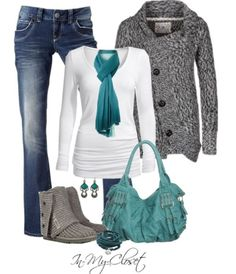 Cute winter outfit!! Black and white sweater!! Medium washed boot cut jeans!! Blue purse and blue scarf!! Short grey UGGs!!