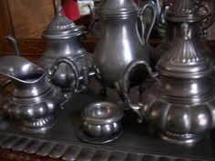Pewter coffee and tea service. Pewter Art, Antique Pewter, Copper, Brass, Iron Decor, Tea Service, Acanthus, Coffee Set, Cool Lighting