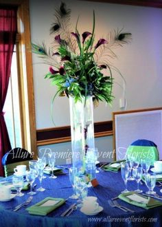 Beautiful peacock feathers in an arrangement make an awesome centerpiece