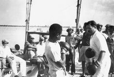 Ernest Hemingway boxing with a man on a dock in Bimini, Bahamas, 1935.
