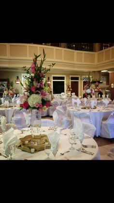 Reception arrangements made of mixed pink florals in a glass tall vase