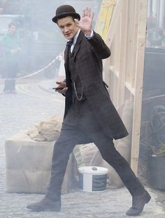 Matt Smith smiled and waved at photographers during takes while filming the new series of Doctor Who.