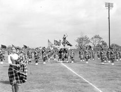 The Dunedin Scottish Highlander Marching band performs at the Dunedin, Florida Highland Games in 1975. The piper in front is Kendall Kline.